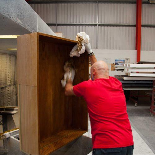 Polishing furniture with white sheeting rags